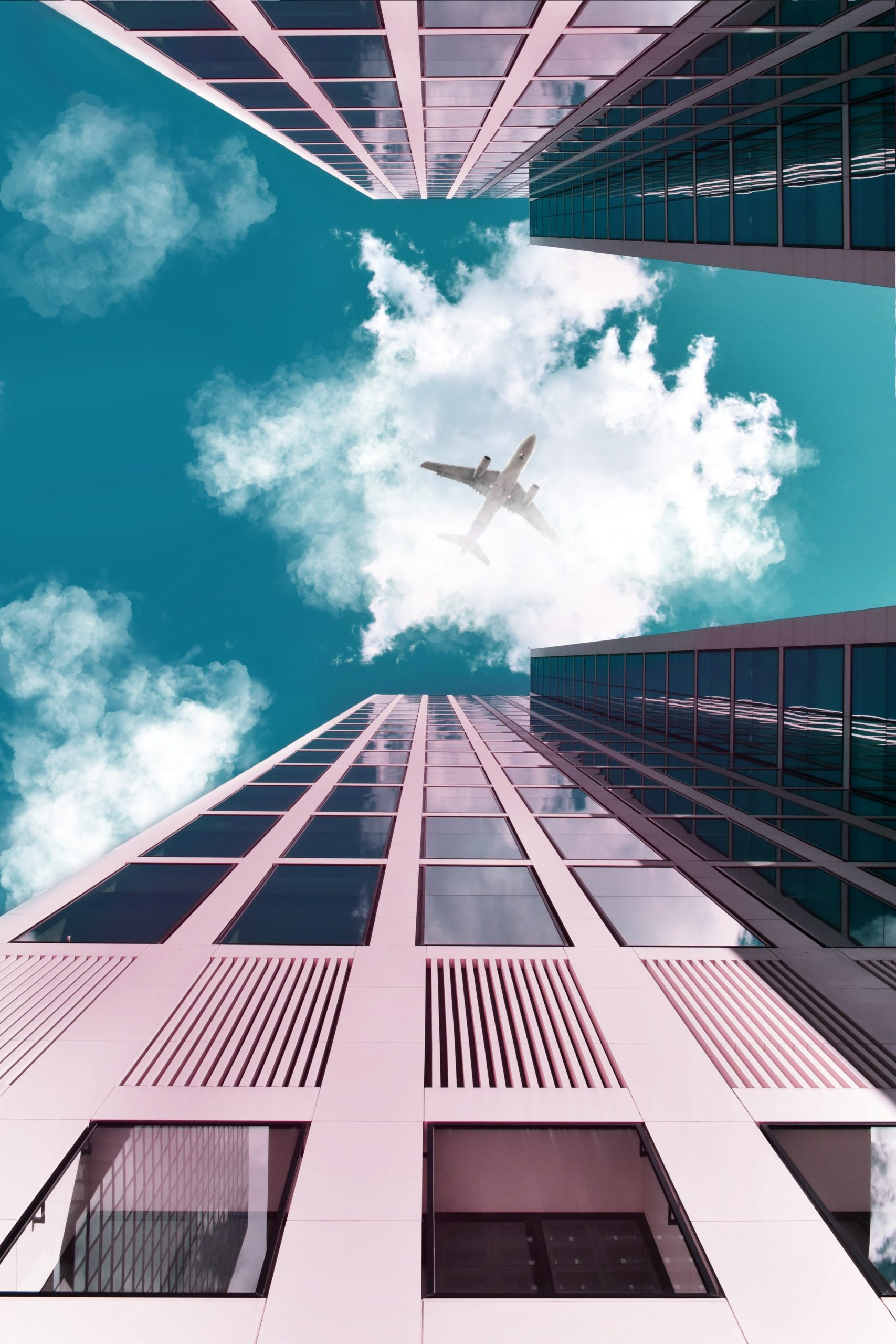 an-airplane-flying-over-the-buildings-2887976